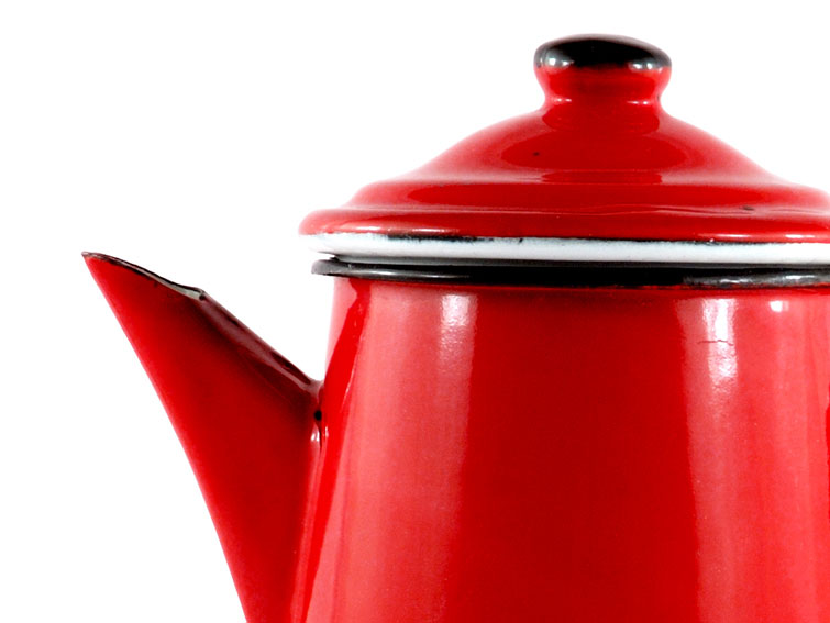 Domestic whistling kettle in red vitreous enamel